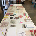 Overview of a variety of handmade papers including natural fibers and pulp stencils