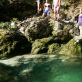 Torrente di montagna. Jumping in the cold river. Lake Bohinj, Slovenia