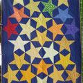 Ein Schulanfangsquilt mit Islamischen Sternen aus dem Jahr 2003