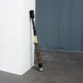 'untitled (sculptors secret weapon #2)', wood, iron, nails, varnish, leather, stone hammer, ⌀15 x 103 cm, 2014