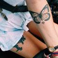 Tatouage papillon bras