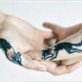 Tatouage loups mains