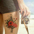 Tatouage bouquet de fleurs cuisse