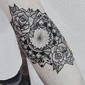 Tatouage fleurs mandala