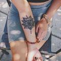 Tatouage plante mandala bras femme