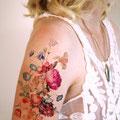 Tatouage fleurs colorées bras