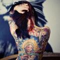 Tatouage vierge à l'enfant et têtes de mort