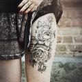 Tatouage fleurs cuisse femme