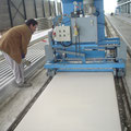 Rectifying machine for hollow core slabs