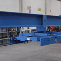 Lifting beams and clamps for hollow core slabs