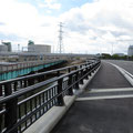 1052 地蔵川河口橋梁の架替え完了(後方左が天然ガス発電所、右が新地発電所)