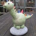 Dino auf Granit-Gletscherkiesel