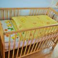 höhenverstellbares Kinderbett aus Holz