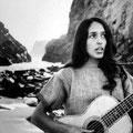 Folk Singer Joan Baez Strumming Her Guitar on the Beach Near Her Home.