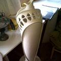 Tall pierced porcelain piece on turntable