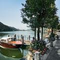 Morgenstimmung mit Holzboot am Luganersee bei Morcote (Tessin). © Switzerland Tourism / Nico Schaerer