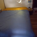 THE REAL BED NAKED WITH YELLOW LIGHT GOING THROUGH THE HEADBOARD