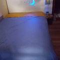 THE REAL BED NAKED WITH BLUE LIGHT GOING THROUGH THE HEADBOARD
