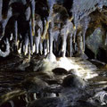 On the left hand side of the cave there is a water stream with lots of stalactites.