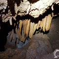 Stalactites hanging from the ceiling.