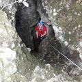 Descending the vertical cave.