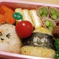 2011.7.8  夏の行事のお弁当。プチトマトの存在感がすごい…。