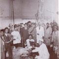"""1934- Inaugurazione del Macello comunale. A sx, col camice bianco, """"Massa Nardo"""" Benvenuto. A dx, col camice bianco, Vincenzo Benvenuto."""