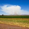 Unterwegs nach Joburg: Ein Buschfeuer in der Ferne!