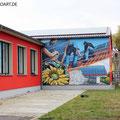 Sonnenhandwerker fassadengestaltung mit Wandbild und Firmenlogo gestaltet in Fürstenwalde mit der Graffiti Kunst im schönen Brandenburg Oder Spree