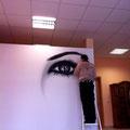 Kunst an der Wand in deutschland mit Graffitikünstler Firmenlogo Firmenimage
