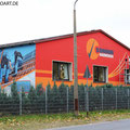 Sonnenhandwerker fassadengestaltung mit Wandbild und Firmenlogo gestaltet in Fürstenwalde mit der Graffiti Kunst im schönen Brandenburg Oder Spree. Solar Solaranlage.Empfangsbereichgestaltung