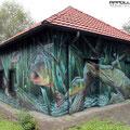 Wandbild auf die Außenfassade einer Wasserpumpstation gemalt Graffiti Airbrush