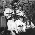 THE CORVAIRS 1964 Staand: Gerard Tubbergen (sologitaar), Rob Meesters (basgitaar) Zittend: Benny de Roest (gitaar, zang), Frans Huizinga (slaggitaar), Henk  (drums) Foto gemaakt in café Las Vegas