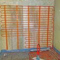 Wand- und Fußbodenheizung in einem Bad