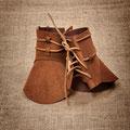 Sur-bottes en cuir. © 7 et une Lieues