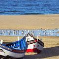 Fischerboot am Strand.