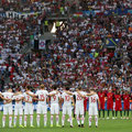 Fans and players stand in silence for the victims of the Istanbul Ataturk Airport terror attack, prior to the Euro 2016 match between Poland and Portugal at the Stade Velodrome in Marseille, France on June 30, 2016, (AFP/Anadolu Agency)