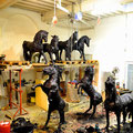 Theme: Mass movement: Title: Black gold. 9 different Horse sculptures in tar-bitumen