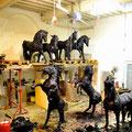 Theme: Mass movement: Title: Black gold. 9 different Horse sculptures in tar-bitumen