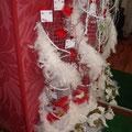 Boutique robes de mariée plumes blanc et rouge