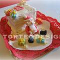 Torta al cacao, copertura in crema al burro, decorazioni in fondente di zucchero