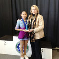 Dorothy Szto receives the 2013 Skate KC Outstanding Performance Award from Audrae Gillespie