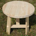Table ronde de 55 cm de haut et 55 cm de diam.