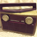 1957 Motorola tube portable, the handle rotates.