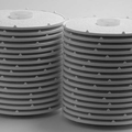 Cellulose sheets attached to the plates form a lens module.