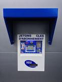 Distributeur de jetons pour station de lavage auto