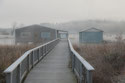 Guntersville lake house boathouse in morning fog