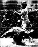 Greg Luzinski breaks up a double play in the first inning.