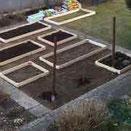 Holzrahmen für Gartenbeete bauen