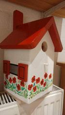 Huisje met klaprozen